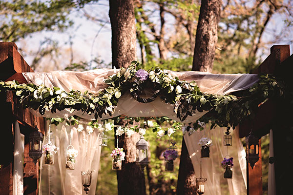 Image of arbor decorated - Whispering Oaks Wedding Venue